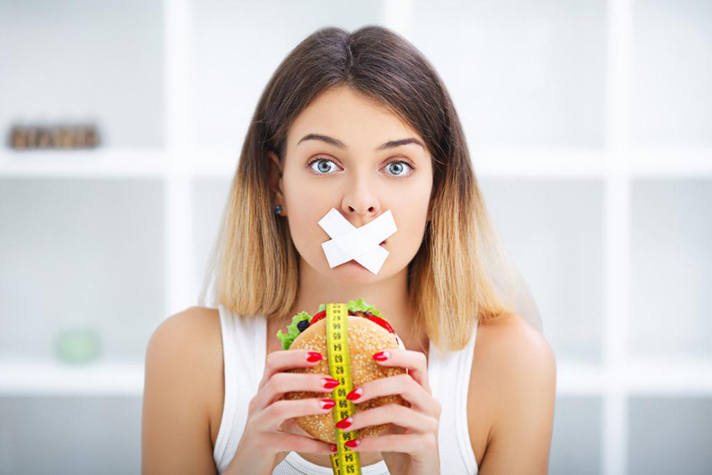 Girl taped mouth cheeseburger