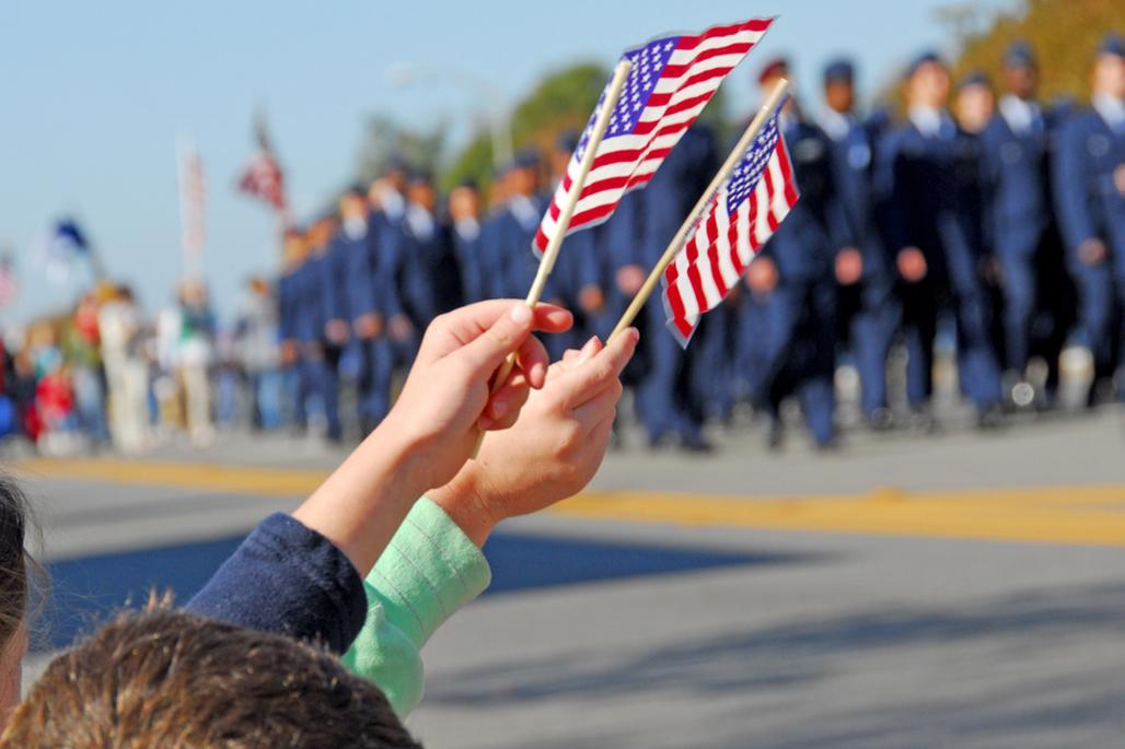 Waving American flag at military parade