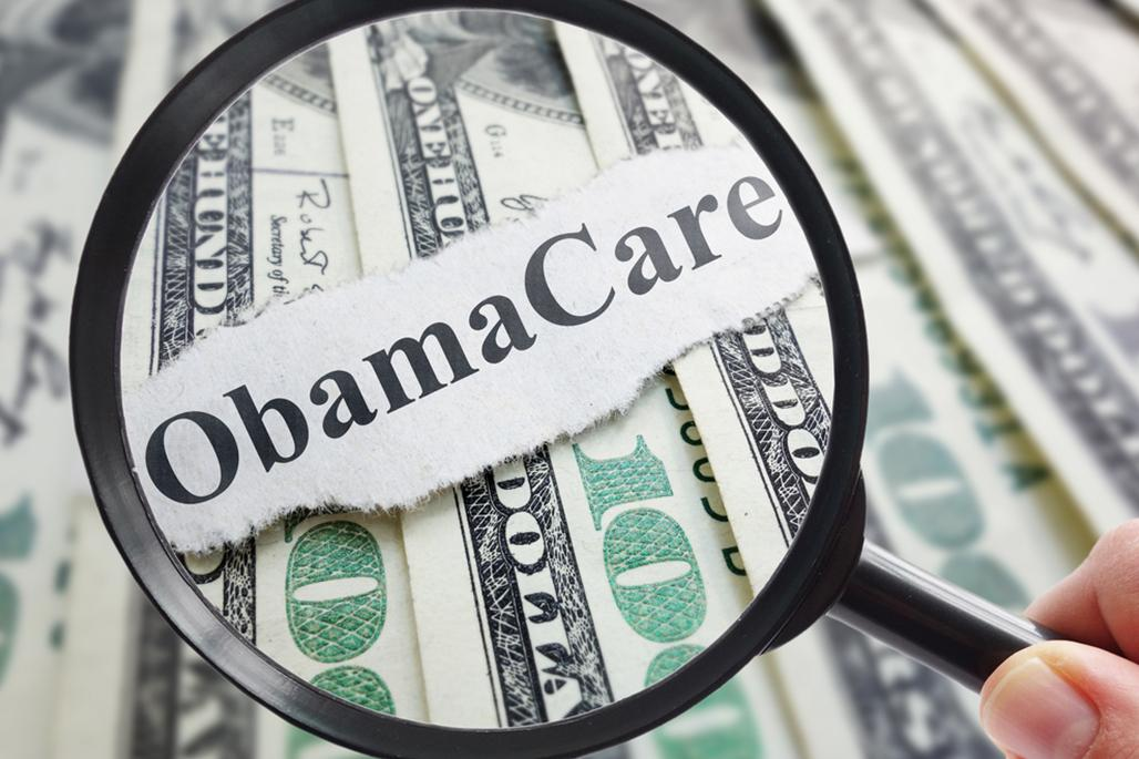Magnifying glass Obamacare money