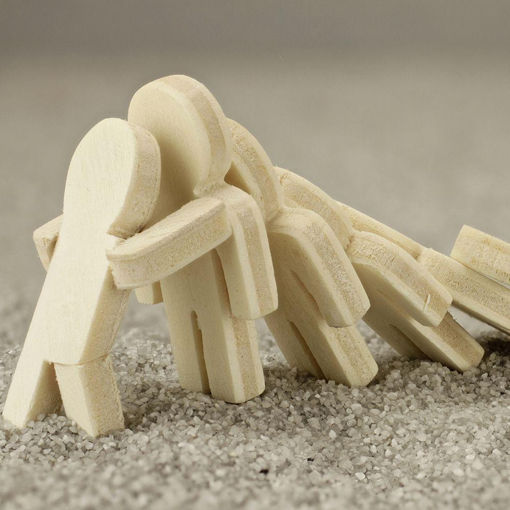 Domino figures held up