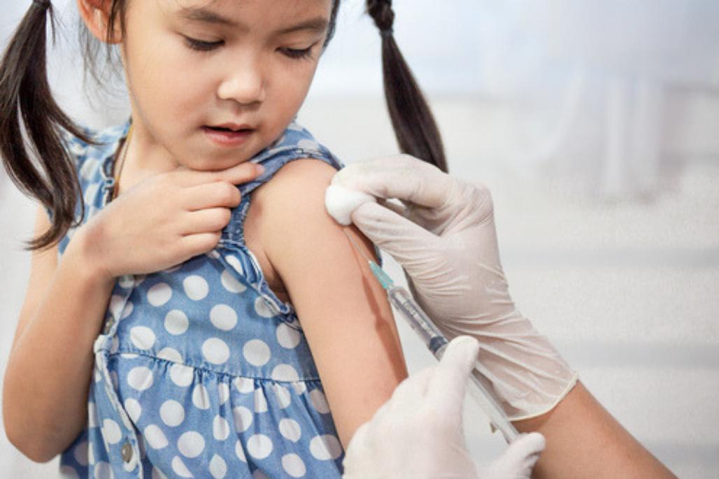 girl getting flu shot