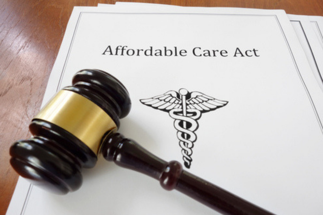 Affordable Care Act papers with gavel