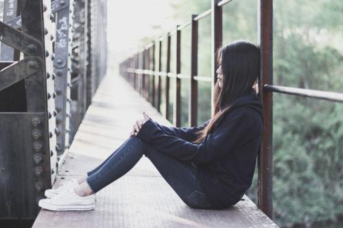 Depressed woman bridge