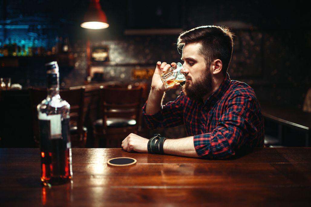 Man drinks alone
