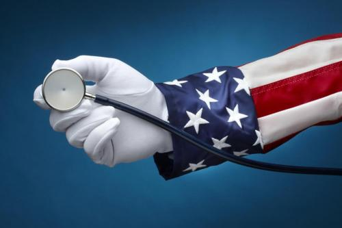American flag arm holding stethoscope