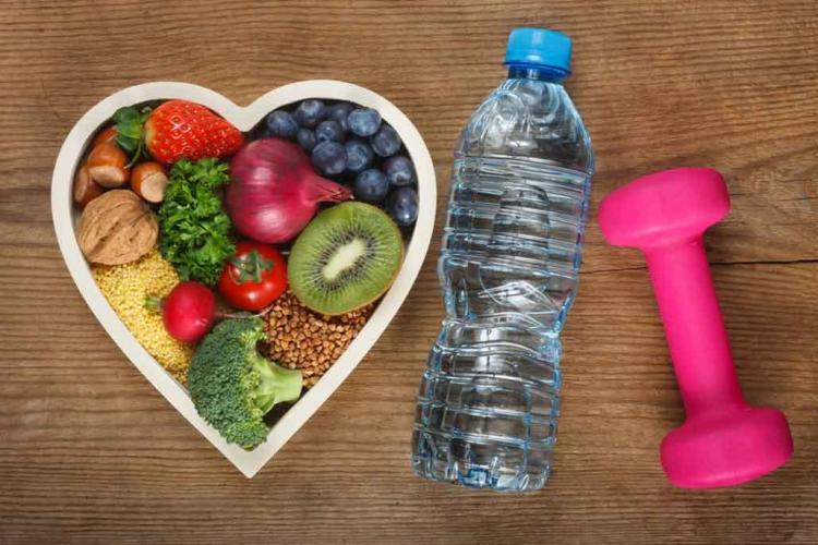 Fruit in shape of heart with water and a weight