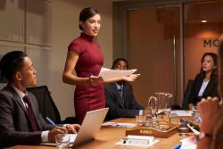 Female boss addressing employees
