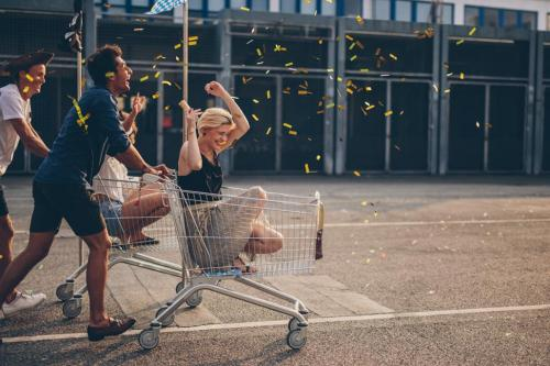 Young adult in shopping cart