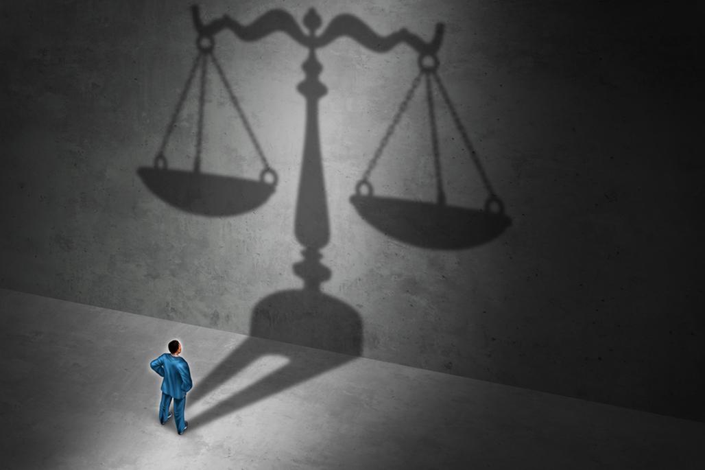 Man weighing justice