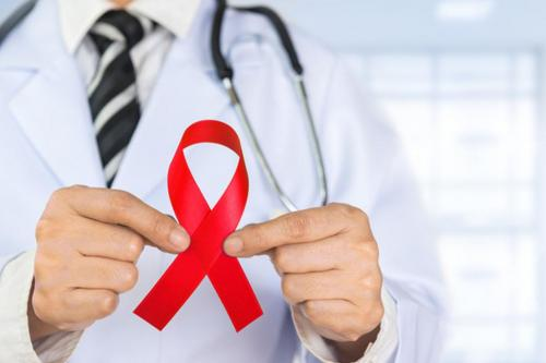 Doctor holding HIV ribbon