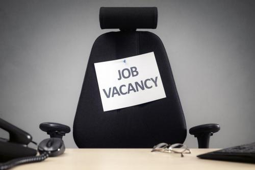 Job vacancy sign pinned to chair