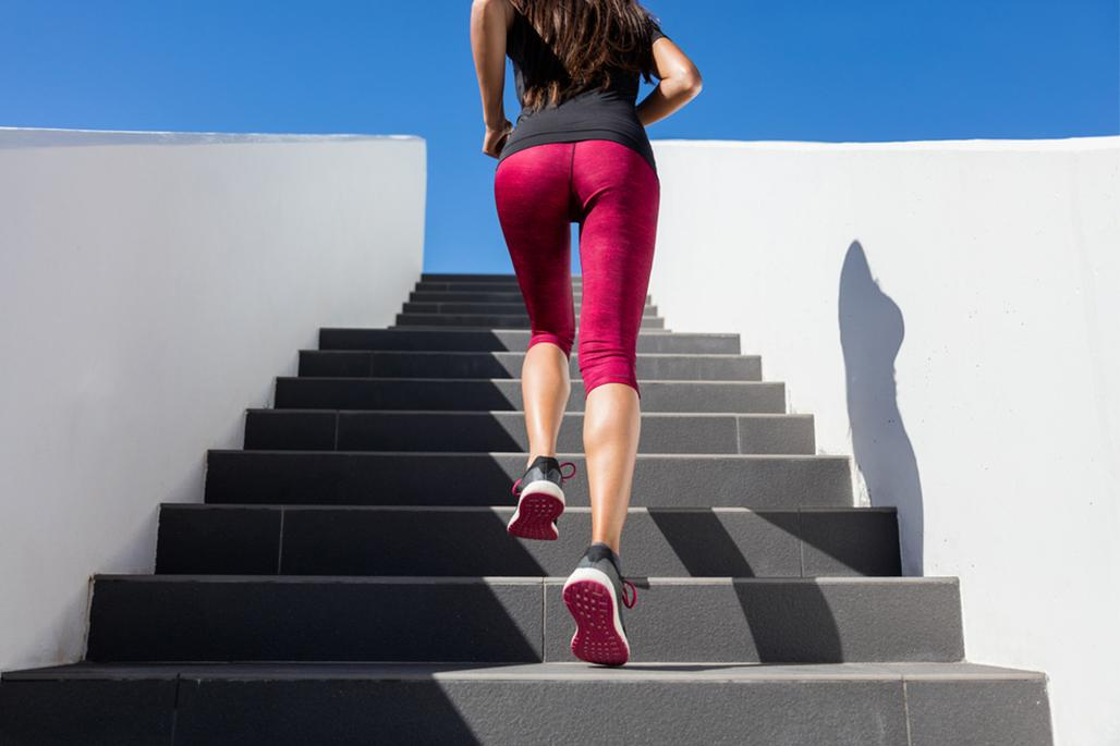Athletic female running up stairs