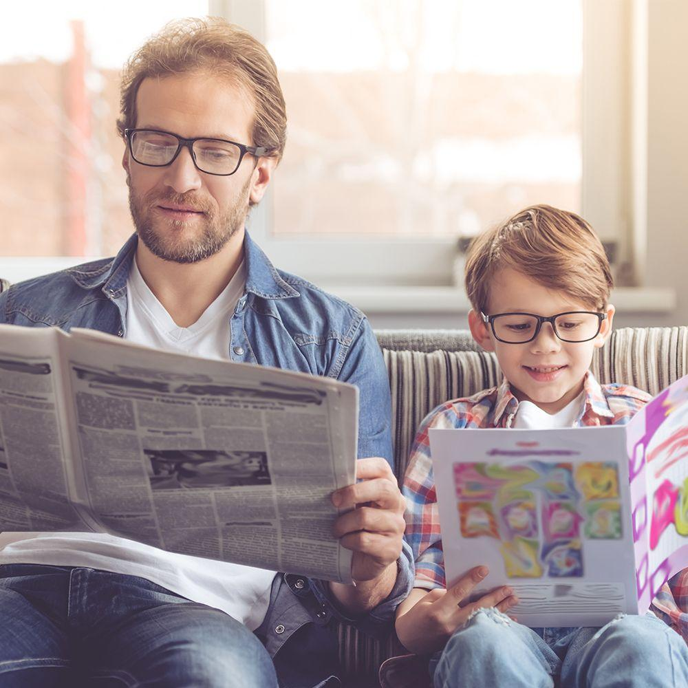 Father son reading news