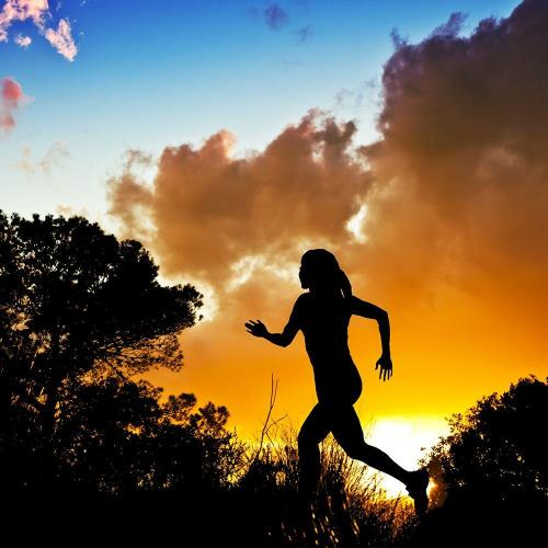 Woman running sunset