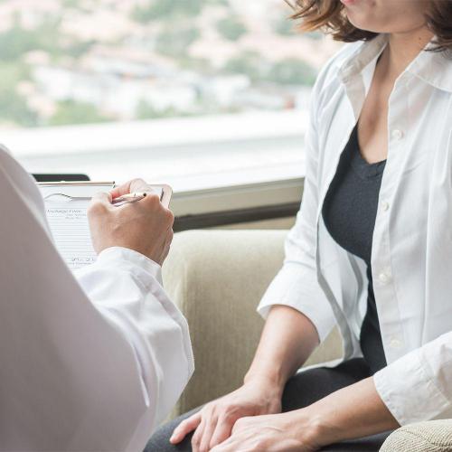 Doctor diagnosing woman