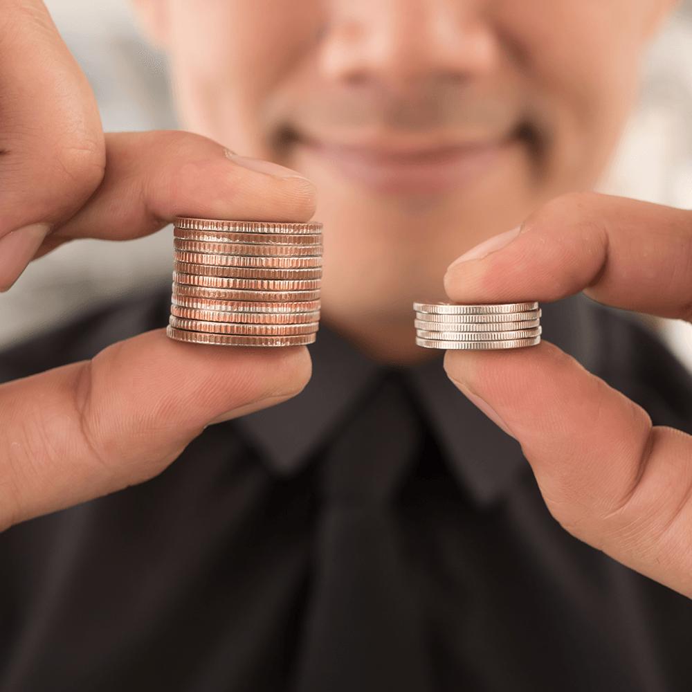 Man comparing coins