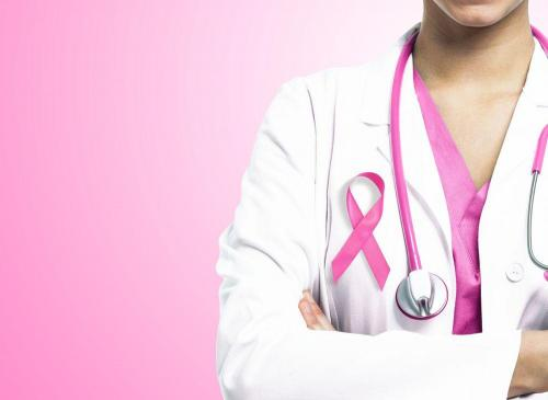 Doctor wearing pink ribbon